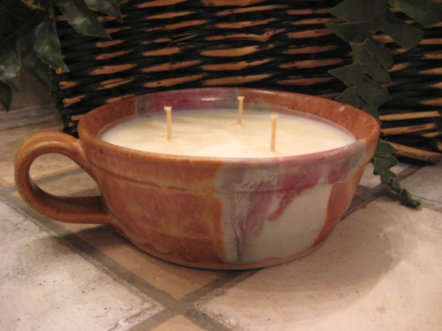 14 oz Soy candle in handcrafted pottery
